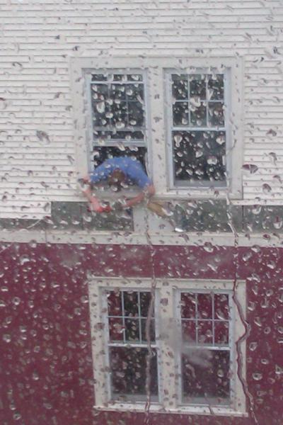Neighbor drilling down the rest of his siding after Sandy's heavy winds tore some off and hit my window next door....