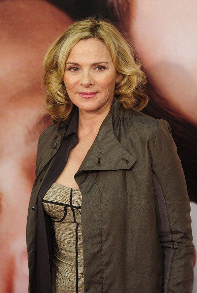 Actress Kim Cattrall walks the red carpet as she arrives for the showing of 'The Five-Year Engagement' which opens the 2012 Tribeca Film Festival in New York, April 18, 2012.