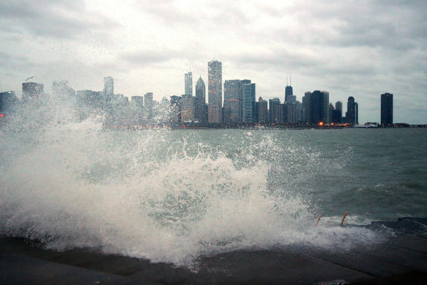 Large waves on Lake Michigan crash at the waters edge near the Adler Planetarium in Chicago.