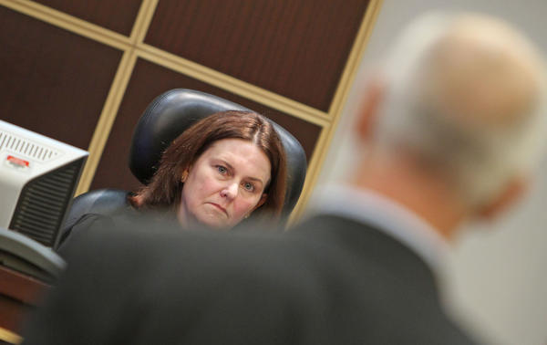Judge Lisa T. Munyon,left,listens to attorney Charles Greene as he requests a change of venue for upcoming civil trial.