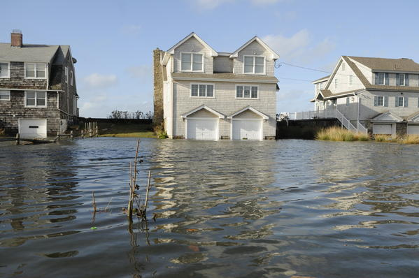 Beachfront homes on Plum Bank Road in Old Saybrook are flooded from Hurricane Sandy's powerful storm surge.