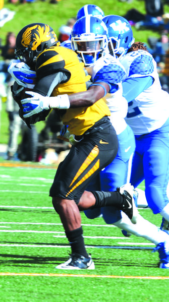 Kentucky defensive back J.D. Harmon tackles a Missouri ball-carrier during the Wildcats loss Saturday. Harmon turned down a scholarship offer for 2013 to walk on this season because he wanted to play right away.
