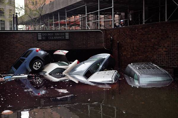 Cars float outside a flooded  parking garage following Hurricane Sandy's hit in the Financial District of New York. The storm has claimed at least 16 lives and caused massive flooding across much of the Atlantic seaboard. President Barack Obama has declared the situation a 'major disaster' for large areas of the U.S. East Coast, including New York City.