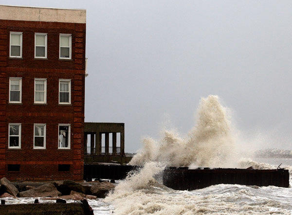 Waves crash against the demolished section of a boardwalk in the north end of the city in the aftermath of Hurricane Sandy's landfall in Atlantic City, New Jersey, October 30, 2012.