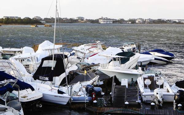 Photos: Hurricane Sandy: Boats piled up by storm surge and the high tide are clustered in a pile at a marina in East Quogue, New York.