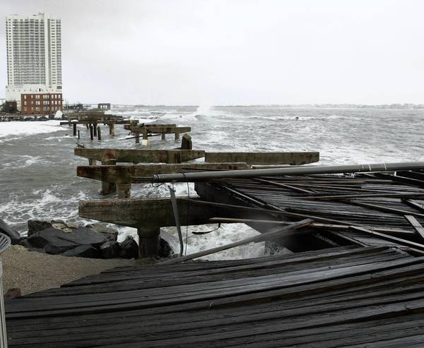 Photos: Hurricane Sandy: Remains of a demolished section of the boardwalk are scatter about at the end of Pacific Avenue in the north end of Atlantic City after Hurricane Sandy made landfall.