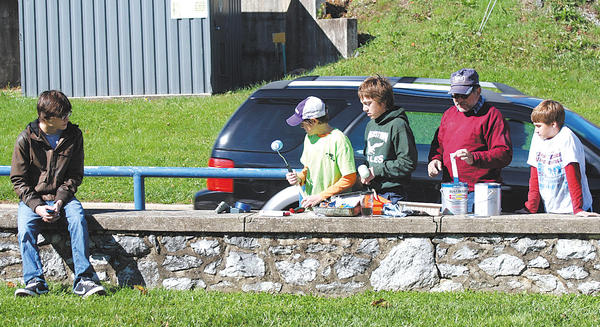 Members of Boy Scout Troop 23 who painted the guard rail are, from left, Jackson Spickler, seated, Kaleb Morris, Will Hildebrand, Rich Gaver (Scoutmaster) and Jake Pence. Not shown is Kendall Morris, the troop treasurer.