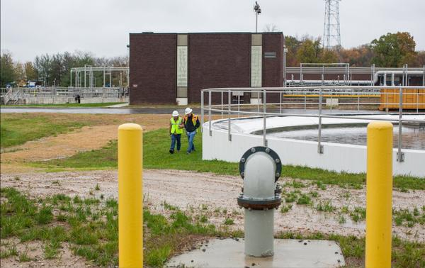 Workers at the Little Patuxent Reclamation Plant walk through the plant on Tuesday, Oct. 30 during the spill.