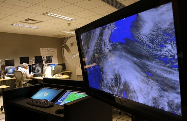 "A satellite image of Hurricane Sandy is shown on a computer screen at the National Hurricane Center in Miami. The National Weather Service's website for the Eastern region of the U.S. went offline Tuesday because of a ""systems failure."""