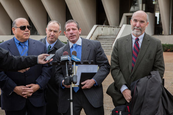 Attorneys (l-r) Joseph Lopez, Steve Greenberg, David Peilet and Joel Brodsky talk to reporters after a hearing for Drew Peterson at the Will County Courthouse in Joliet today. Joel Brodsky, the longtime attorney for Drew Peterson, will no longer be representing him.