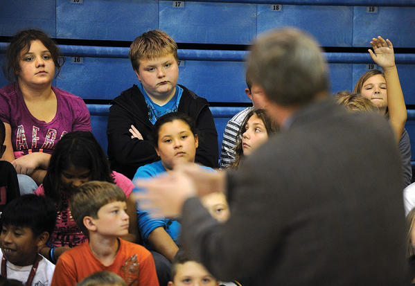 U.S. Rep. Ben Chandler answers a question from Nick McCoy, second from left, during his visit to fifth grade students at Strode Station Elementary, top photo. Listening next to McCoy is Destiny Napier. Chandler, who debated Republican challenger Andy Barr Monday evening, spoke about his job in Washington, the upcoming election, the three branches of government and how the government operates, bottom photo. The students have been studying about government and the election process.
