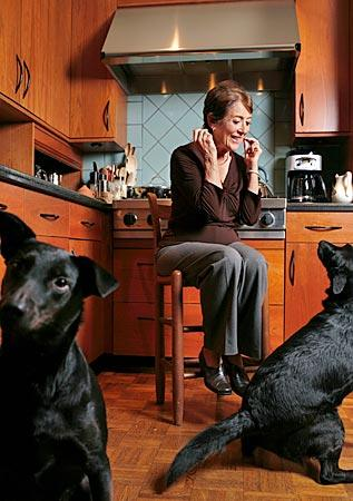 """I really loved doing those dinner parties,"" says Nina Lamb, with her canine helpers in her Santa Monica home. "". . . It was something that was part of our life."""
