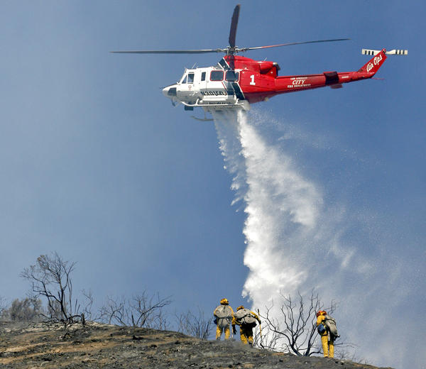 A City of L.A. Fire Dept. helicopter drops water on a fire on the hills north the 134 Frwy. east of the 2 Frwy. oin Eagle Rock on Tuesday, Oct. 30, 2012.  The fire was knocked down in about 2 hours.