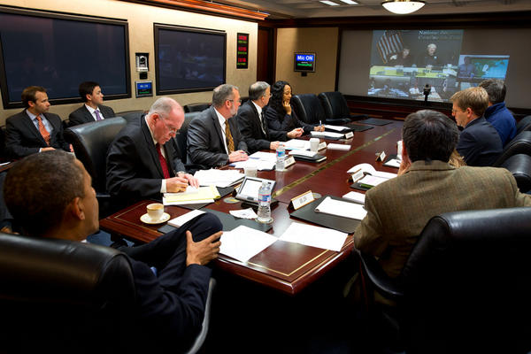 In the Situation Room at the White House, President Obama receives an update on the official response to Sandy.