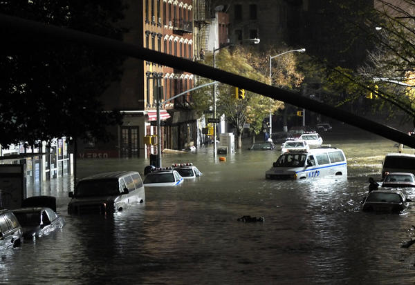 Photos: Hurricane Sandy: Cars become submerged on Avenue C and 7th Street in New York as Hurricane Sandy makes its way through Manhattan.