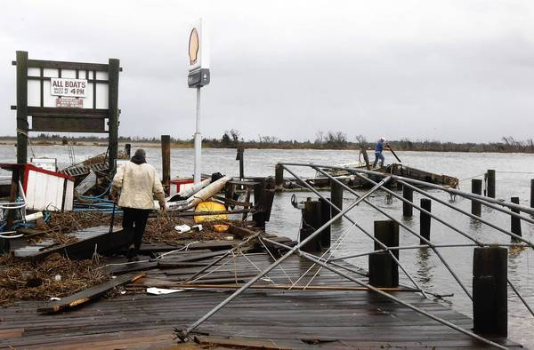 Photos: Hurricane Sandy: Ted Wondsel of Point Lookout, owner of Teds Fishing Station, assesses the damage on October 30, 2012 in Long Beach, New York.