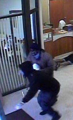 FBI agents are searching for two armed suspects who robbed the City County Credit Union in Sunrise