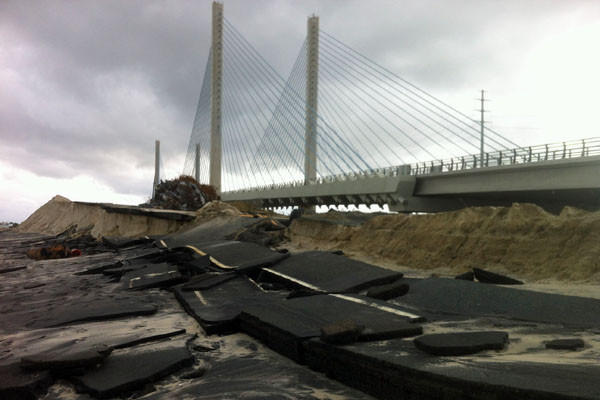 A bridge along the Delaware coast stands undamaged beside its shattered predecessor.