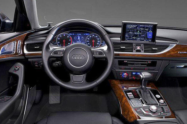"The Audi A6 and other vehicles with voice commands allow drivers to make phone calls, set navigation destinations or turn up the heat. <a href=""/la-fi-autos-audi-a6-review-20110915,0,2003920.story"">Audi A6 review</a>"