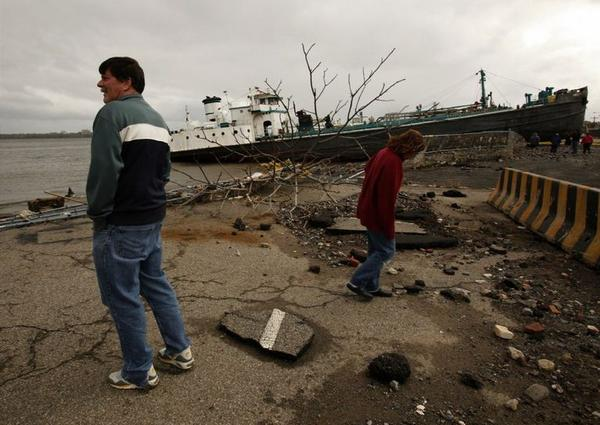 On Staten Island, New York, a large ship is grounded on Front Street, Tuesday, October 30, 2012, as residents assess damage after Hurricane Sandy.