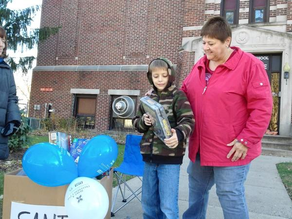 Karen Westerlund and Blake Benson, 9, drop off some toys for the SANTA project.