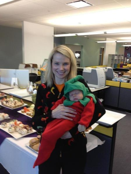 Yahoo CEO Marissa Mayer poses for a photograph with her 1-month-old son, Macallister, in matching chili pepper Halloween costumes.