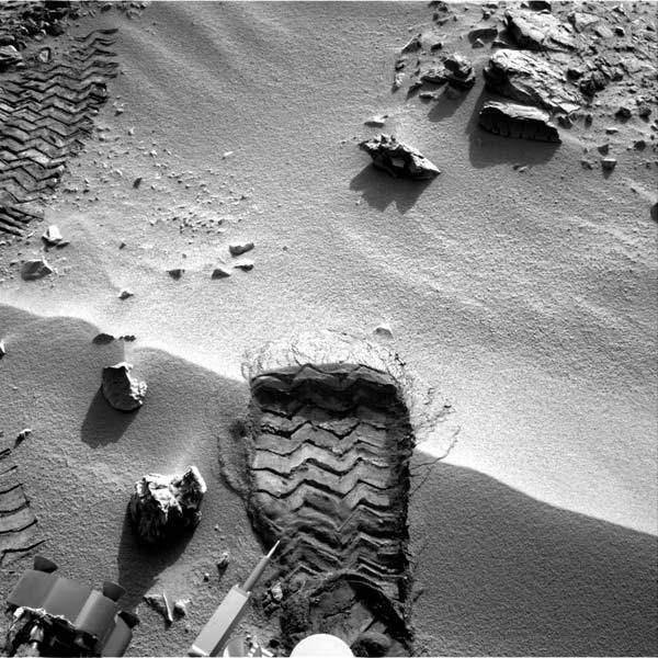 "NASA's Mars rover Curiosity cut a wheel scuff mark into a wind-formed ripple at the ""Rocknest"" site in this handout photo."