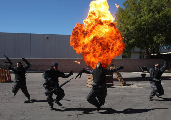 Stunt people react to an explosion during one of the scenarios.