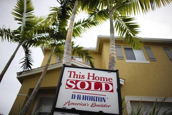 The Standard & Poor's/Case-Shiller home price index for the 20 largest U.S. metropolitan areas rose 0.9% from July and 2% from August 2011. Above, a sold sign on a new house in Miami.