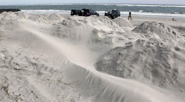 Sand mounds on the beach provide a buffer as North Wildwood, N.J., prepares for Sandy.