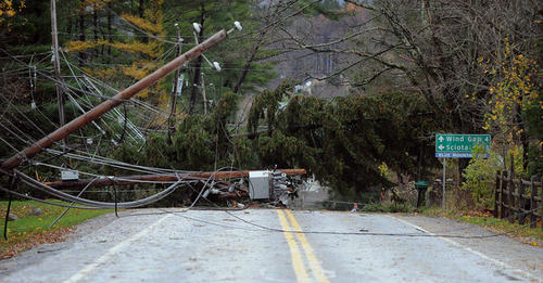 Utility poles and down trees line the Easton Wilkes-Barre Turnpike / Old 115 in Saylorsburg after Hurricane Sandy rolled through the region Tuesday morning.