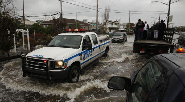 Emergency vehicles in Queens, N.Y., fight through floodwaters to help evacuate residents.