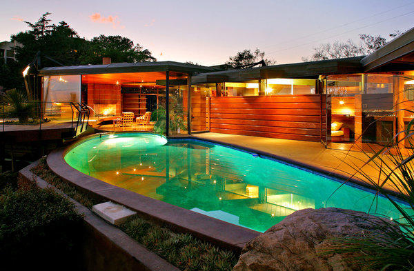 The swimming pool takes a dip into the living room, which has a retractable wall of glass.
