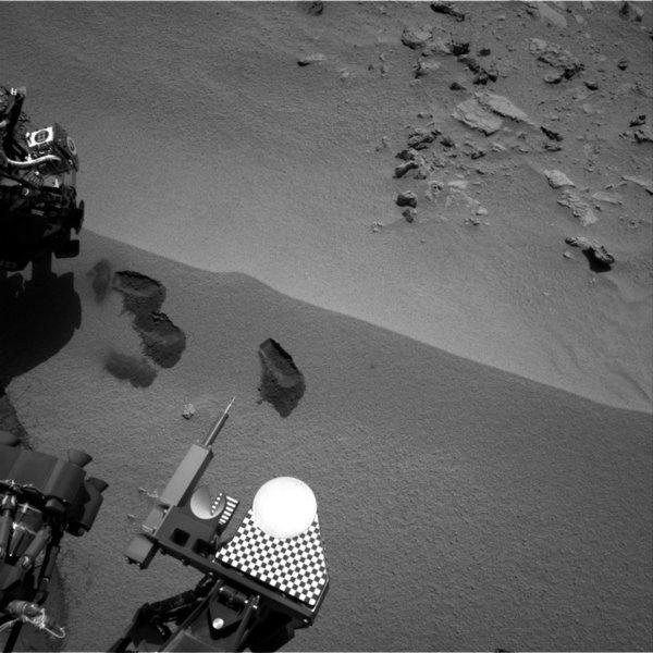 "Three ""bite marks"" left in the Martian ground by the scoop on the robotic arm of NASA's Mars rover Curiosity, in an image taken by the rover's right navigation camera during the mission's 69th Martian day, or sol, Oct. 15. The third scoopful, collected on that sol, left the bite, or pit, farthest to the right."