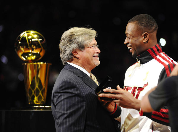 Miami Heat owner Mickey Arison hands Dywane Wade his Championship ring at the American Airline Arena before the season opener against the Boston Celtics.