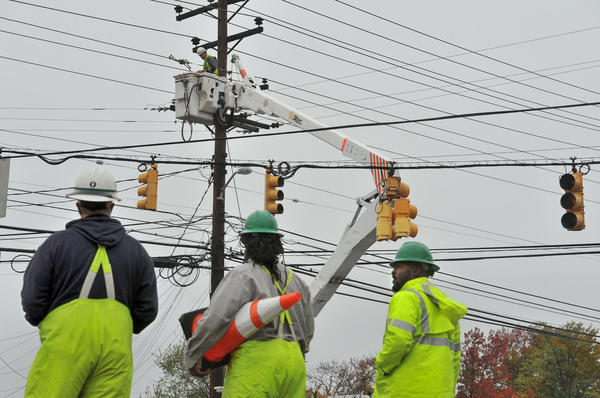 BGE workers at the intersection of Ft. Smallwood Road and Hilltop Road repair lines the day after Sandy hit the region.