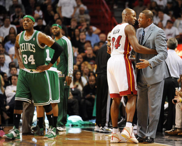 Ray Allen of the Heat greets his former coach Doc Rivers of the Celtics in the first quarter.