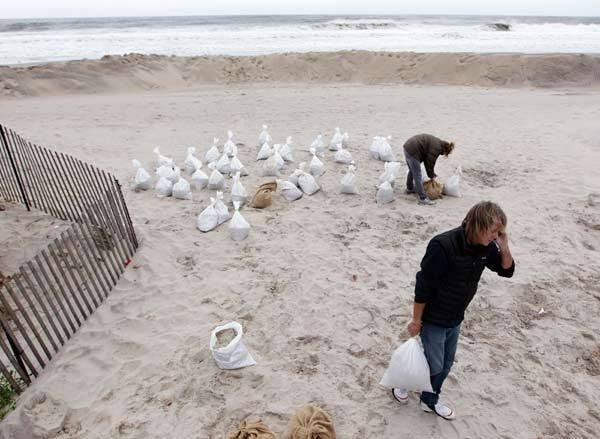People gather sand bags at the Belle Harbor section of Rockaway beach in the Queens borough of New York.
