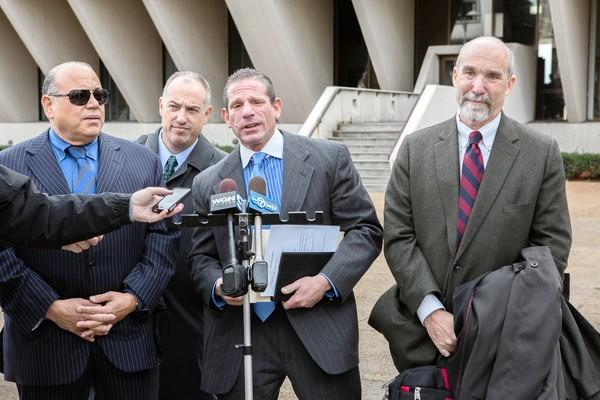 Drew Peterson attorneys Joseph Lopez, from left, Steve Greenberg and David Peilet speak to the press Tuesday after Joel Brodsky, right, withdrew from the convicted ex-police sergeant's defense team.