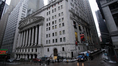 The streets surrounding the New York Stock Exchange are deserted as financial markets remain closed for the second day due to superstorm Sandy, Tuesday. Superstorm Sandy could mean a slower economy and higher gas prices in coming months, though reconstruction will help cushion the economic blow.