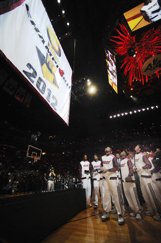 In October 2012, the Miami Heat hang their championship banner at the American Airlines Arena in Miami. A proud moment for fans, team and owner.