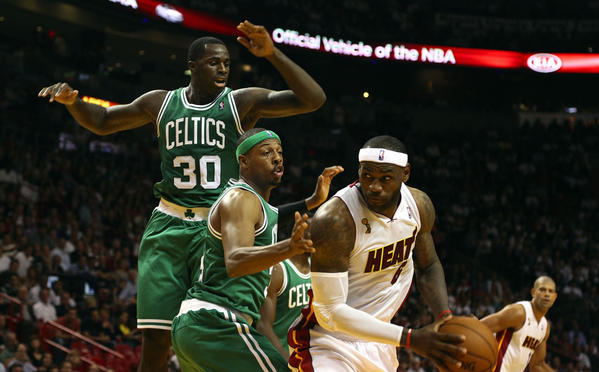 Boston Celtics #30 Brandon Bass and #34 Paul Pierce try to defend Lebron James during the second quarter at the American Airline Arena during the season opener against the Boston Celtics.