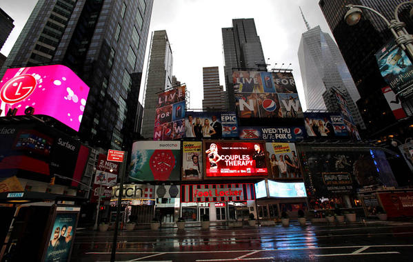 Times Square is deserted on the morning after the storm.