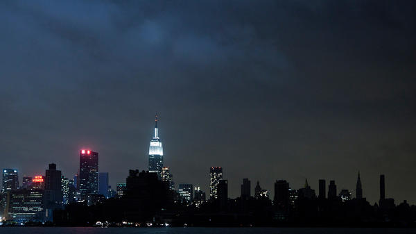 Much of the New York City skyline sits in darkness a day after Sandy, but the famed New York Marathon is still scheduled to take place Sunday.