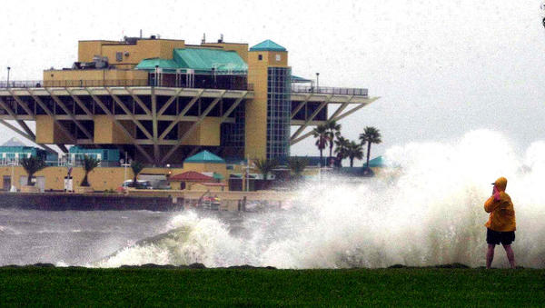 High waves from Hurricane Gordon crash over a sea wall 17 September, 2000, at the St. Petersburg Pier in downtown St. Petersburg, Florida. Gordon, a category one hurricane, is forecasts to make landfall along Florida's western coast late 17 September. The National Hurricane Center reported Gordon has sustained winds of 120kph (75mph). Coastal residents have been urged by officials to flee inland.