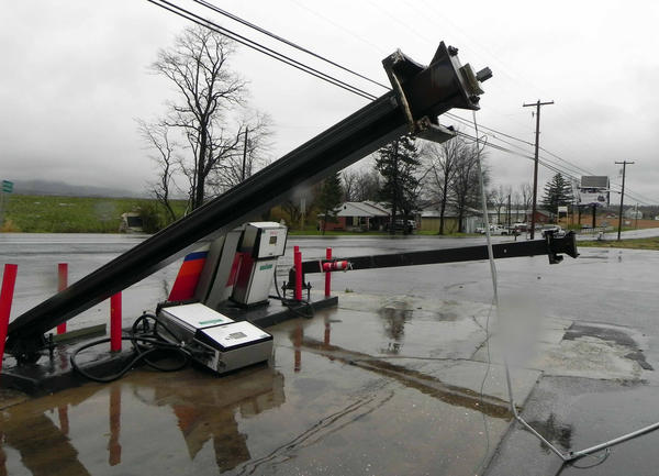 The pumps and metal sign posts at St. Thomas Gas and Diesel were bent over by Superstorm Sandy as it blew through Franklin County Monday night.