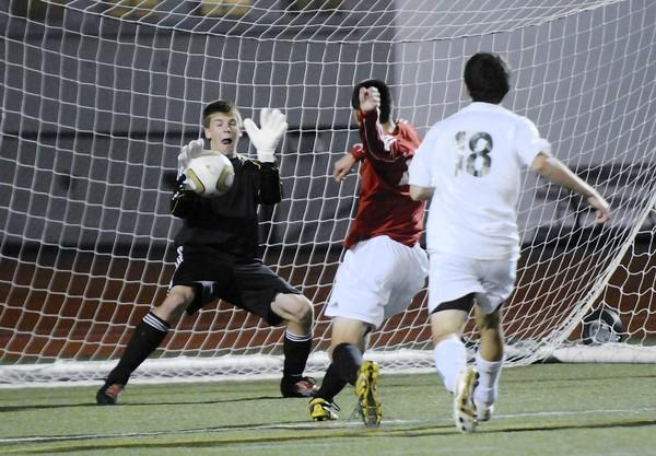 Emmaus goal keeper Kevin Fine blocks a shot from Easton's Andrew Mellott during the Lehigh Valley conference boys soccer semifinals on Tuesday, October 19, 2010 at J. Birney Crum Stadium.