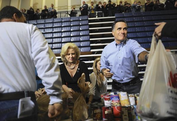 Mitt Romney, originally in Kettering, Ohio, to campaign, helps collect and pack donated goods for victims of the storm.