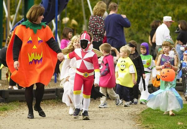 The typical school Halloween parade, like this one in Mundelein in 2000, is apparently too scary for administrators at Skokie/Morton Grove School District 69, which has banned Halloween celebrations this year.