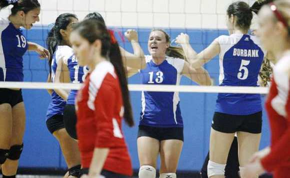 Burbank High's Katie Hooper celebrates among teammates during Tuesday's match against Burroughs.